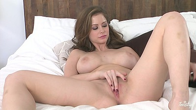 Busty Emily Addison inserting objects into own pussy