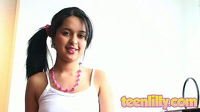 18 year old Teen Lilly sitting by her laptop showing flat teen chest